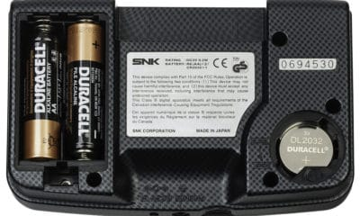The back of a Neo Geo Pocket Color, a handheld gaming console released by SNK in 1999. This picture shows the both battery compartment covers removed and with batteries inserted. The Pocket Color uses two AA batteries for gameplay and one 2032 button cell battery for an internal clock. - Photo Credit: Evan Amos via Wikimedia.org