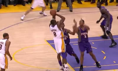 Kobe Bryant (#8) of the Los Angeles Lakers shoots over Raja Bell (#18) and Boris Diaw (#3) for the Game Winner of Game #4 of the NBA Playoffs in 2006 - Screenshot Photo Credit: NBA on ABC