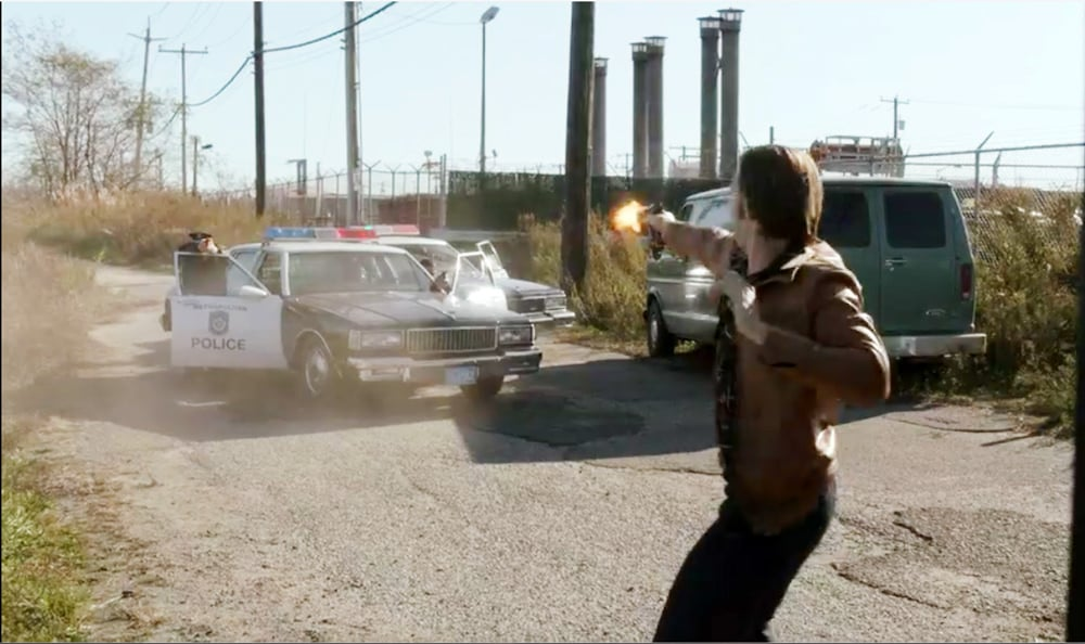 """Bill Heck as Young Mickey Donovan shoots back in vain on Showtime's Ray Donovan Season 7 Episode 7 """"The Transfer Agent"""" - Screenshot/Photo Credit: Showtime"""