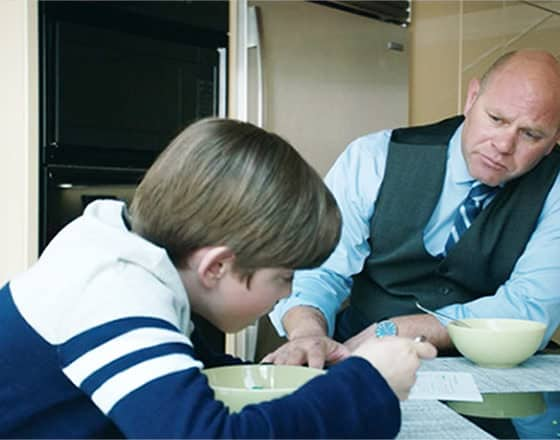 Domenick Lombardozzi in Cold Pursuit: Fantasy football and loyalty - Nicholas Holmes as Ryan Calcote and Domenick Lombardozzi as Mustang - Screenshot Photo Credit: Summit Entertainment / StudioCanal