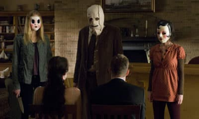 The Strangers (2008) Film - Liv Tyler as Kristen McKay, Scott Speedman as James Hoyt, Laura Margolis as Pin-Up Girl, Kip Weeks as Man in Mask, and Gemma Ward as Dollface in The Strangers - Photo Credit: Universal Studios